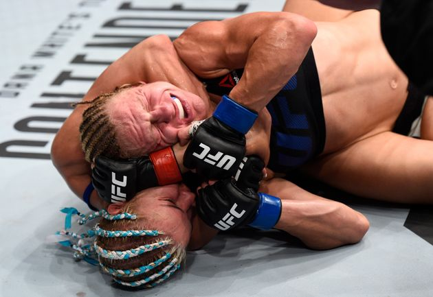 Justine Kish fought off Felice Herrig's rear choke submission attempt but didn't escape an embarrassing...