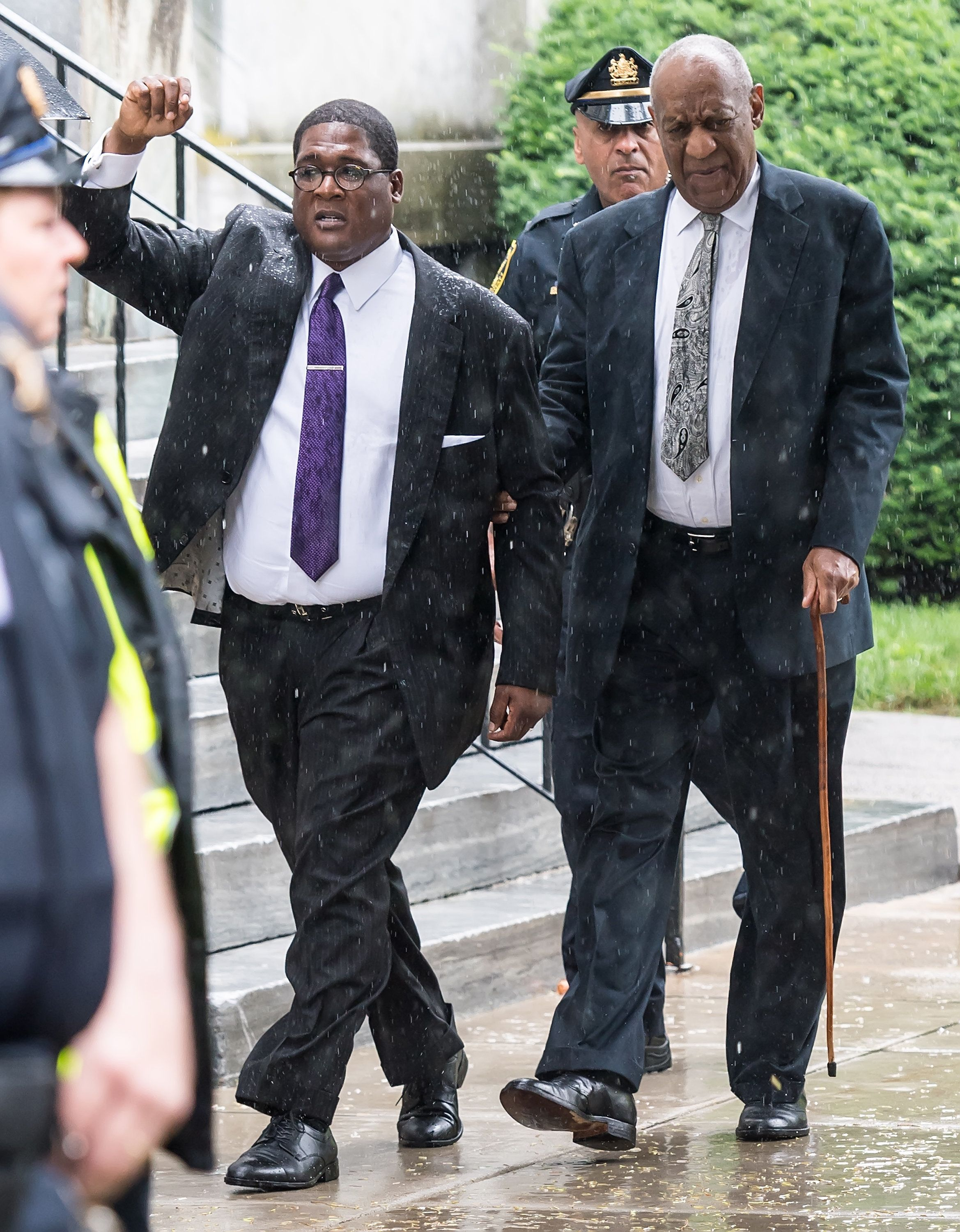 Andrew Wyatt and actor Bill Cosby are seen leaving Montgomery County Courthouse after the sexual assault case was declared a
