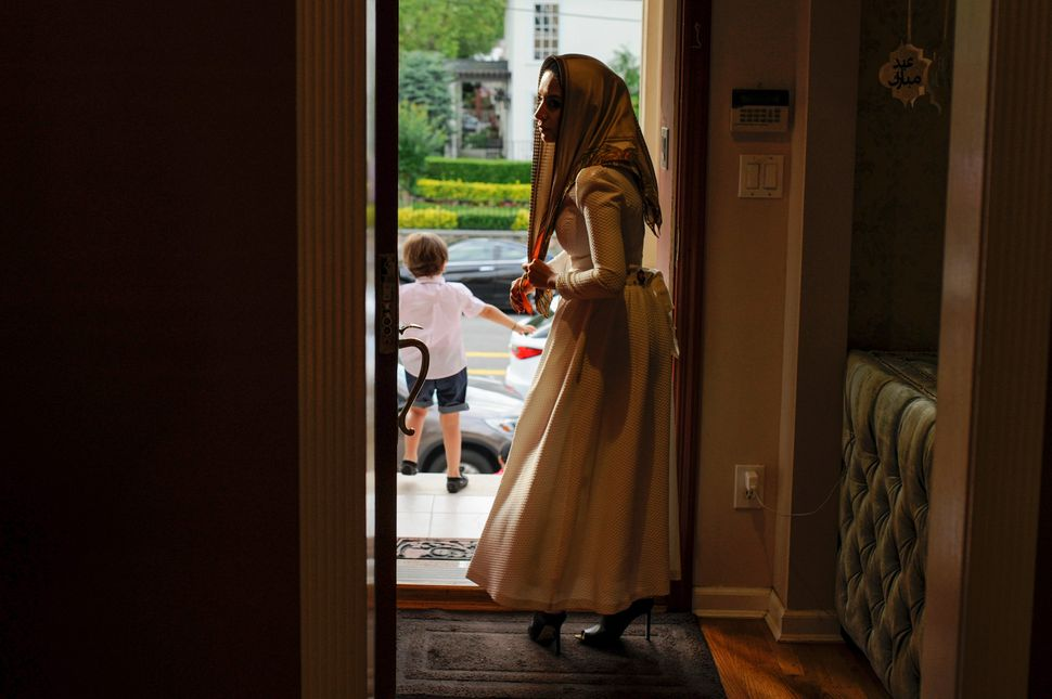 Yemeni-American Muslim Yusra Udayni prepares to leave her home to take part in Eid al-Fitr Islamic prayers in Brooklyn, New Y