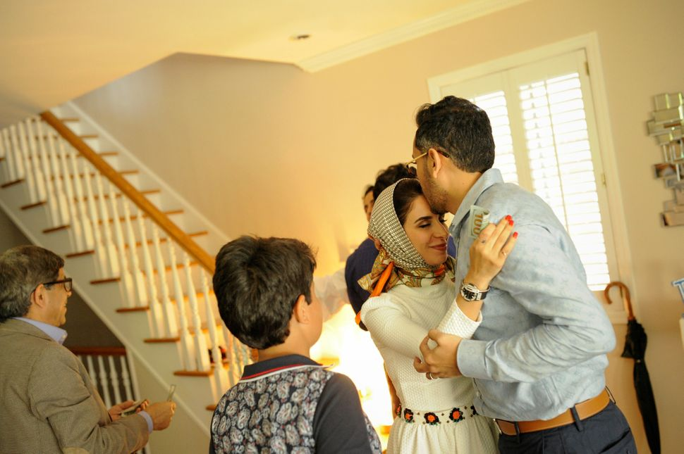Yemeni-American Muslim Talal Radman embraces his wife Yusra Udayni as the family return home after taking part in Eid al-Fitr