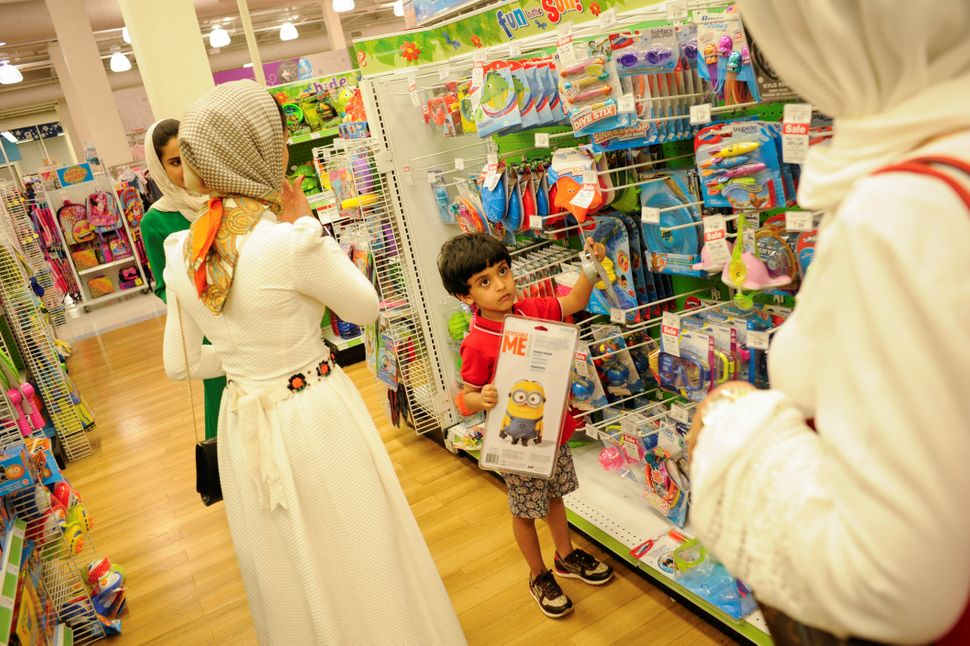 "Yemeni-American Muslim boy Salman Udayni, 5, picks out his Eid gifts at Toys ""R"" Us after the family took part in Eid al-Fitr"