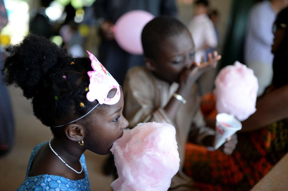 Children eat cotton candy in celebration of Eid al-Fitr at a park in South Brunswick Township, New Jersey, U.S., on June 25,