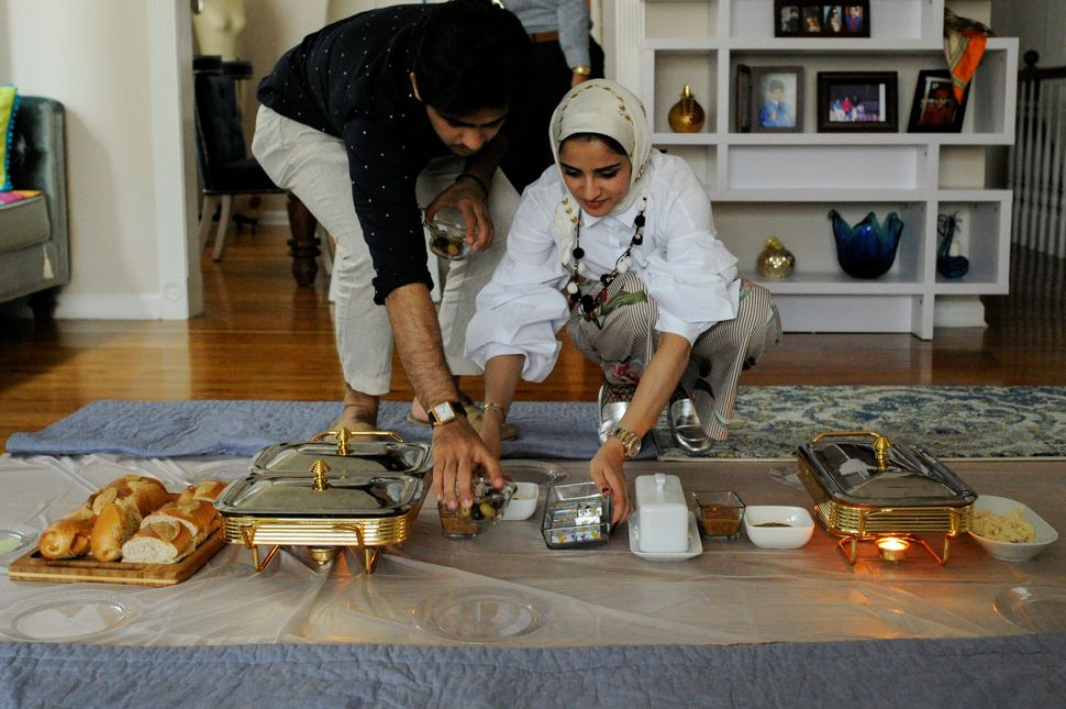Yemeni-American Muslim Abdul Udayni (L) helps his sister Hajar Udayni prepare a breakfast feast to celebrate the Eid al-Fitr