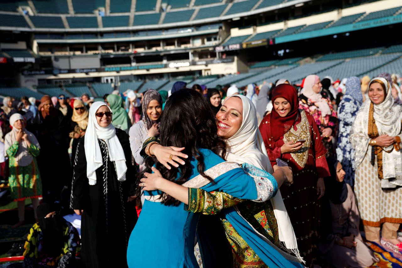 Muslim women hug as they gather for the celebration of the Eid al-Fitr holiday, the end of the holy month of Ramadan at Angel Stadium of Anaheim in Anaheim, California, U.S., June 25, 2017.