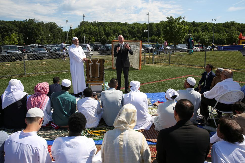 A Muslim congregation attending Eid al-Fitr prayers and celebrations are addressed by Phil Murphy, a gubernatorial candidate,
