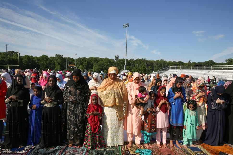 Muslim women take part in Eid al-Fitr prayers at a park in South Brunswick Township, New Jersey, U.S., on June 25, 2017.&nbsp