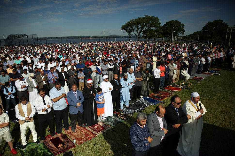 Muslims perform Eid-al-Fitr prayer in Bensonhurst Park of Brooklyn borough in New York, United States on June 25, 2017. Eid-a