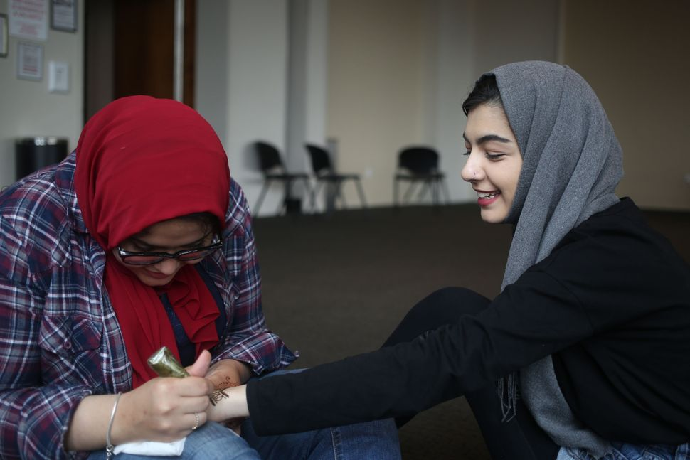 Fatima Elif (R) gets a Henna before Eid-ul-Fitr, a holiday celebrated by Muslims worldwide that marks the end of the Islamic