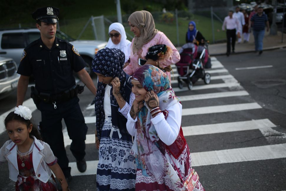 Muslims walk to Bensonhurst Park to perform Eid-al-Fitr prayer in Brooklyn borough of New York, United States on June 25, 201