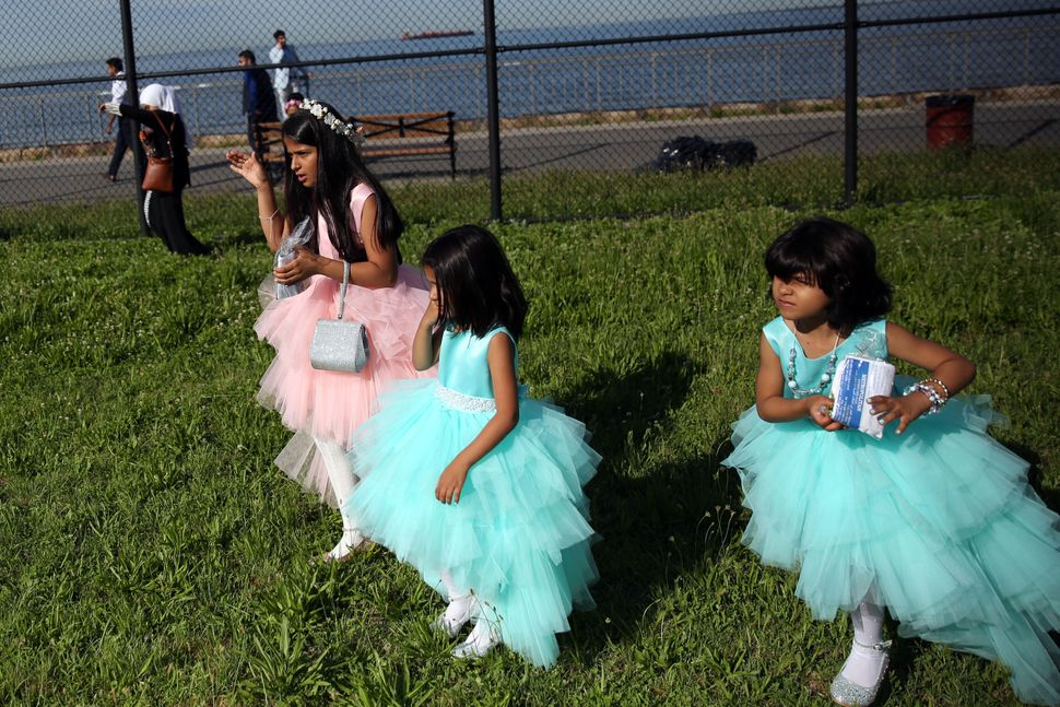 Muslim girls are seen dressed for Eid-ul-Fitr in Bensonhurst Park of Brooklyn borough in New York, United States on June 25,