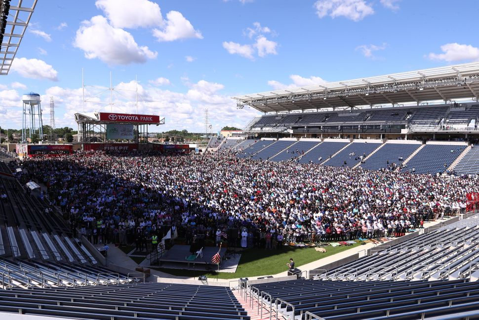 Muslims gather to perform Eid-al-Fitr prayer at Toyota Park Stadium in Chicago, United States on June 25, 2017. Approximately