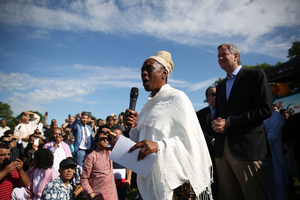 First Lady of New York Chirlane McCray (L) addresses Muslim crowds with Mayor of New York Bill De Blasio (R) after they