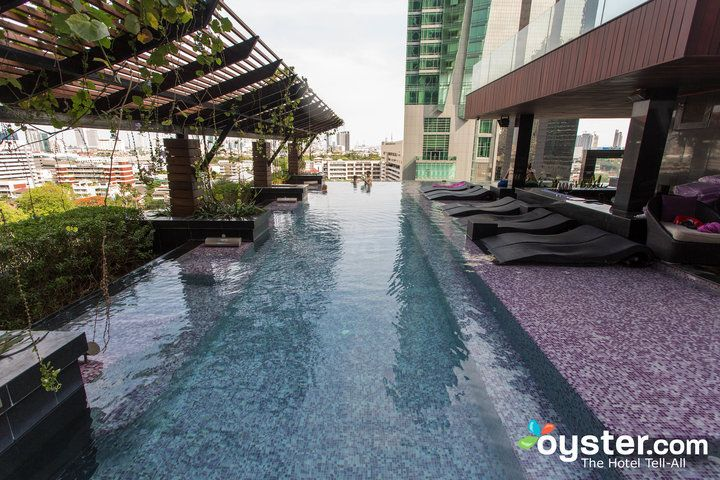 Mode Sathorn Hotels Infinity Pool Wins The Prize In Our Roundup For Design And Style Mini Tiles Range Of Serene Aqua Purple Hues Line Its Bottom
