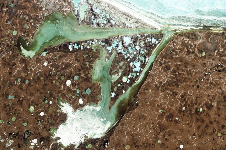 Scientists monitor landscapes like Omulyakhskaya and Khromskaya Bays in northern Siberia closely.