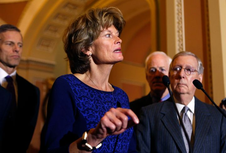 U.S. Senate Majority Leader Mitch McConnell (R-KY) (R) listens to Sen. Lisa Murkowski (R-AL) as she speaks to the media, Janu