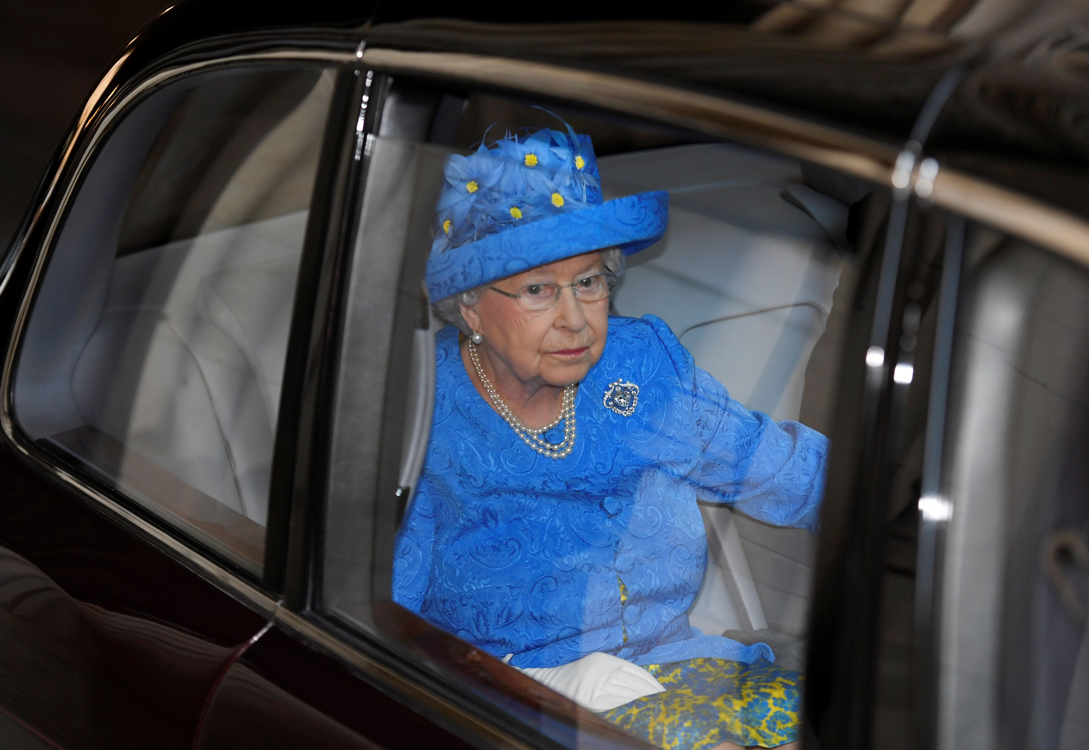 Queen Elizabeth II leaves after the State Opening of Parliament at the House of Lords at the Palace of Westminster on June 21