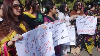 LAHORE, PUNJAB, PAKISTAN - 2016/11/16: Pakistani Transgender community holding placards during protest against torturing a transgender in Sialkot, at outside Lahore Press Club  as the prime suspect, Aijaz Alias Jajja, had allegedly stormed the house of a transgender, Phool, along with his accomplices a few days ago in sialkot. (Photo by Rana Sajid Hussain/Pacific Press/LightRocket via Getty Images)