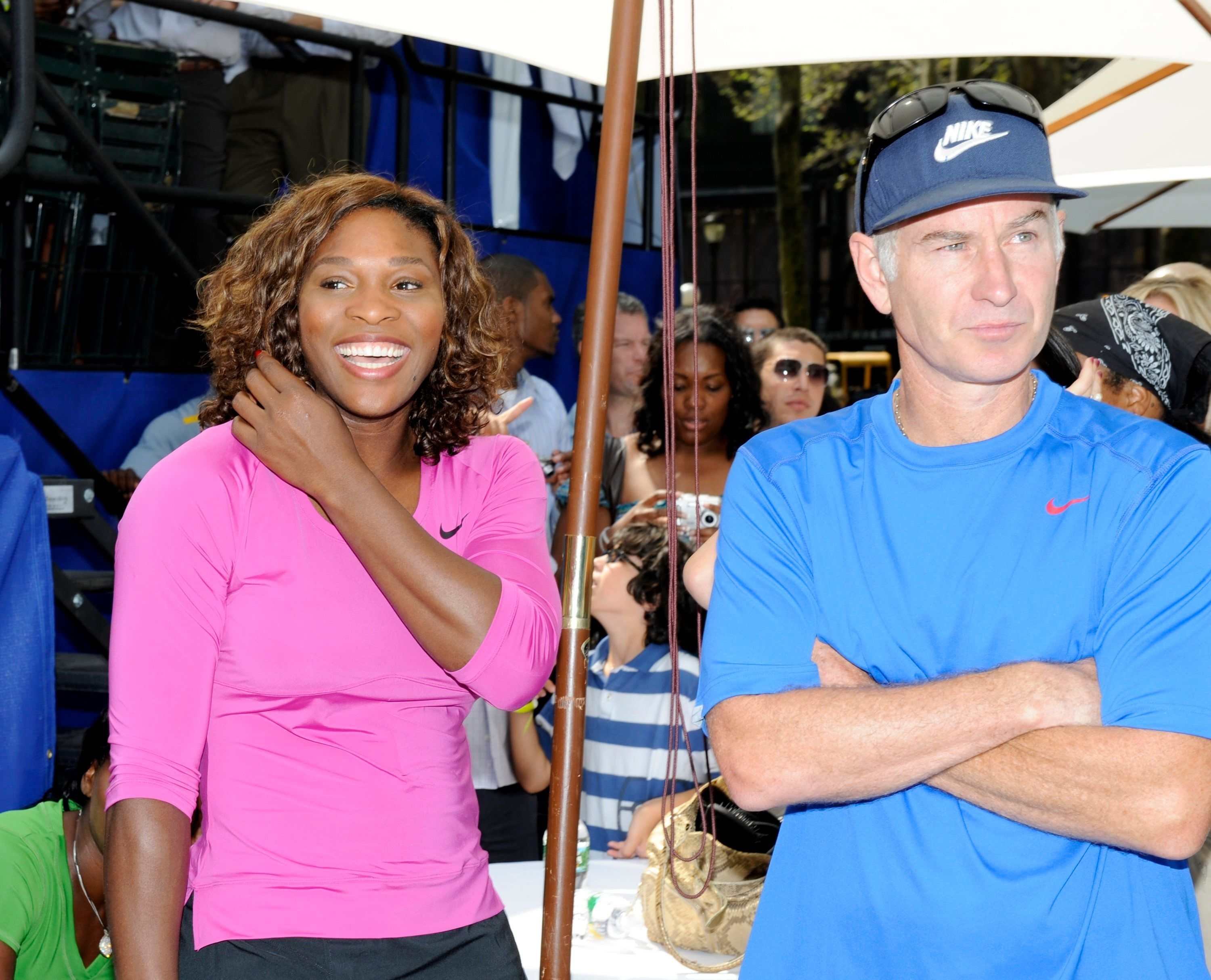 NEW YORK - AUGUST 26: Serena Williams looks on with John McEnroe before their match at the DIRECTV ESPN US Open Experience promoting DIRECTV's mosaic coverage of the US Open August 26, 2009 at Bryant Park in New York Cty. (Rob Tringali/Getty Images for DirecTV)