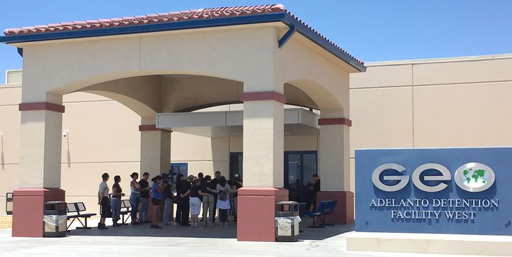 <em>A group of faith leaders pray outside of the Adelanto Detention Facility on Tuesday, June 20, shortly before the lockdown