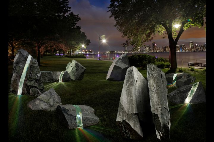 "Some of the nine boulders will be bisected with a ""laminated, borosilicate-glass"" to create rainbow patterns."