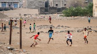 Yemeni children play football in a field in the government-held western Yemeni coastal port town of Mokha, on April 19, 2017. / AFP PHOTO / SALEH AL-OBEIDI        (Photo credit should read SALEH AL-OBEIDI/AFP/Getty Images)