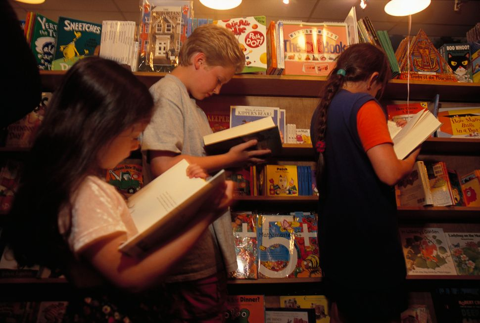 "Children standing online for a new ""Harry Potter"" book at Glassman's Books of Wonder, which has been devoted to children's bo"