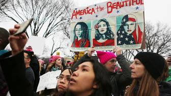 WASHINGTON, DC - JANUARY 21:  Protesters attend the Women's March on Washington on January 21, 2017 in Washington, DC. Large crowds are attending the anti-Trump rally a day after U.S. President Donald Trump was sworn in as the 45th U.S. president.  (Photo by Mario Tama/Getty Images)