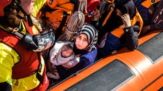 MEDITERRANEAN SEA, LIBYA - JUNE 15 :  Refugees are seen at the Spanish NGO Proactiva Open Arms after being rescued in the Mediterranean Sea, near Libya on Thursday, June 15, 2017. A Spanish aid organization Thursday rescued 420 migrants who were attempting the perilous crossing of the Mediterranean Sea to Europe in packed boats from Libya. (Photo by Marcus Drinkwater/Anadolu Agency/Getty Images)
