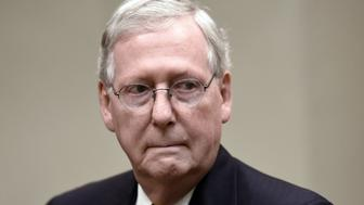 Senate Majority Leader Mitch McConnell, a Republican from Kentucky, attends a meeting between U.S. President Donald Trump, not pictured, and House and Senate leadership in the Roosevelt Room of the White House in Washington, D.C., U.S., on Tuesday, June 6, 2017. Trump is bringing lawmakers to the White House in hopes of kick-starting his legislative agenda while Washington focuses on the latest twists and turns in the Russia investigation. Photographer: Olivier Douliery/Pool via Bloomberg