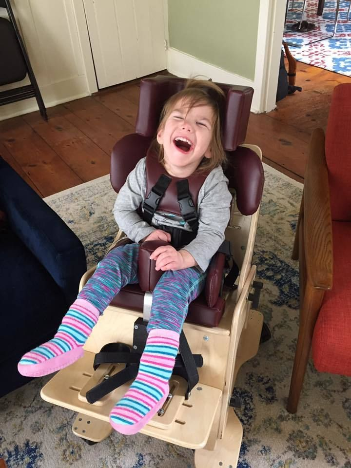<em>Lucia smiling in her new activity chair.</em>