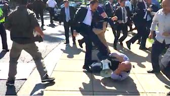 American protester is kicked in the face by man believed to be a bodyguard for Turkish President Erdogan