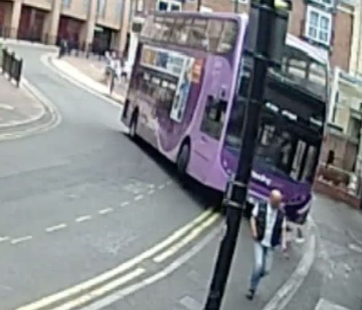 Simon Smith was crossing the road in Reading when a runaway bus tore around the corner behind him...