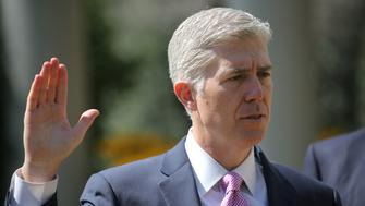 Judge Neil Gorsuch is sworn in as an associate justice of the Supreme Court  in the Rose Garden of the White House in Washington, U.S., April 10, 2017. REUTERS/Carlos Barria