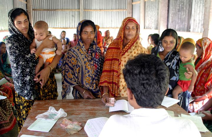 The first microloans were made to women in rural Bangladesh in the 1970s. Banesa Khatun (far left) here in 2006, was still u