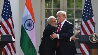 US President Donald Trump and Indian Prime Minister Narendra Modi embrace during a joint press conference in the Rose Garden at the White House in Washington, DC, June 26, 2017. / AFP PHOTO / Nicholas Kamm        (Photo credit should read NICHOLAS KAMM/AFP/Getty Images)