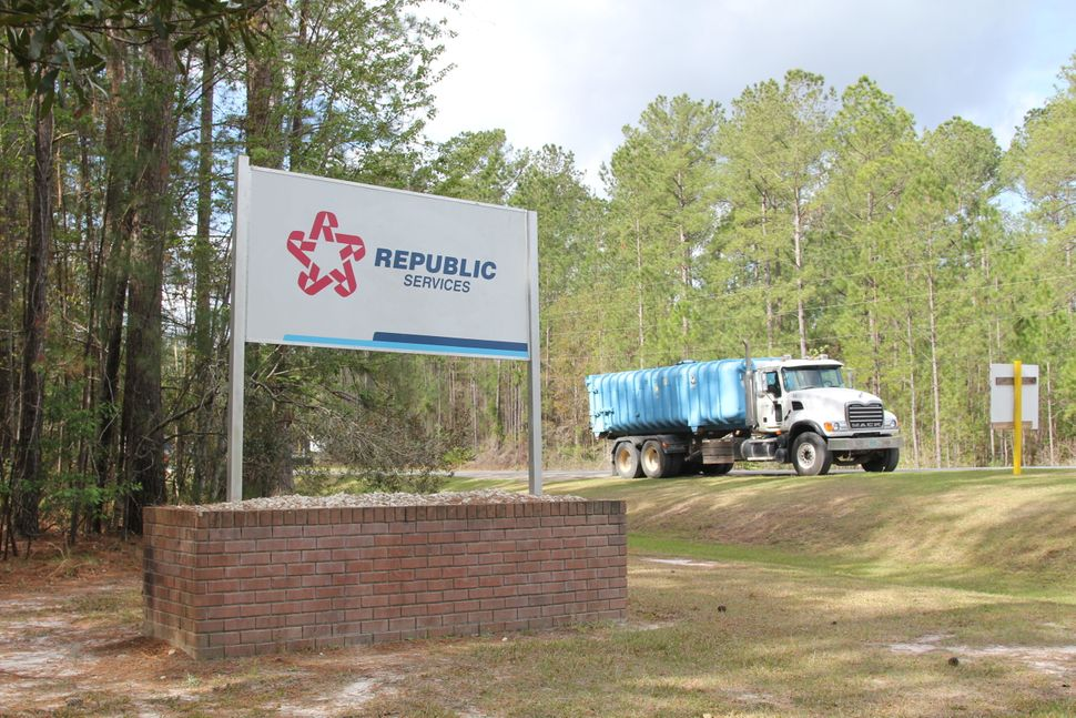A waste-hauling truck leaves a landfill where Republic Services, the second largest waste management company in the Unit