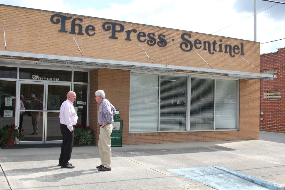 "W.H. ""Dink"" NeSmith (right) talks to a Wayne County resident outside the offices of the Press-Sentinel, a newspaper he has ow"