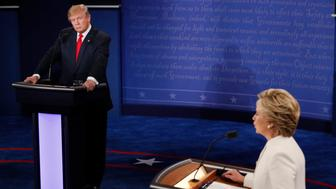 Republican U.S. presidential nominee Donald Trump listens as Democratic U.S. presidential nominee Hillary Clinton speaks during their third and final 2016 presidential campaign debate at UNLV in Las Vegas, Nevada, U.S., October 19, 2016.   REUTERS/Mark Ralston/Pool