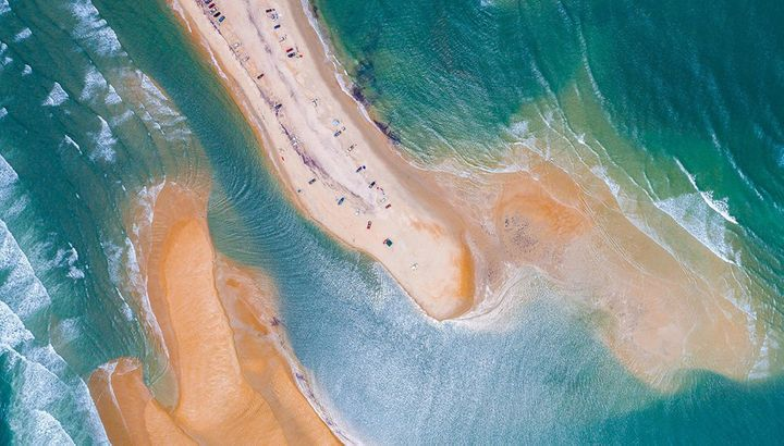 Local photographer Chad Koczera captured photos of the new island with a drone.