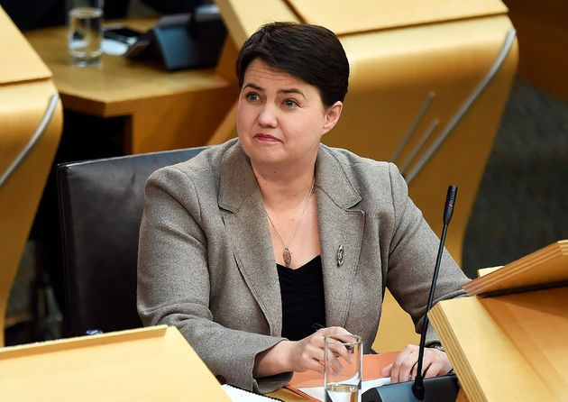 Ruth Davidson listens as Sturgeon speaks at