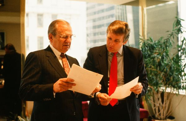 Meeting with Chrysler CEO Lee Iacocca at his New York City office.