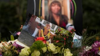 SEATTLE, WA - JUNE 20: Flowers, photos, and other items are placed at a memorial for Charleena Lyles at the apartment building in which she was killed on June 20, 2017 in Seattle, Washington. Officers from the Seattle Police Department shot and killed Lyles, a pregnant mother of four, on June 18.  (Photo by David Ryder/Getty Images)