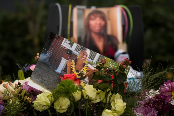 Flowers, photos and other items are placed at a memorial for Charleena Lyles at the Seattle apartment building where she