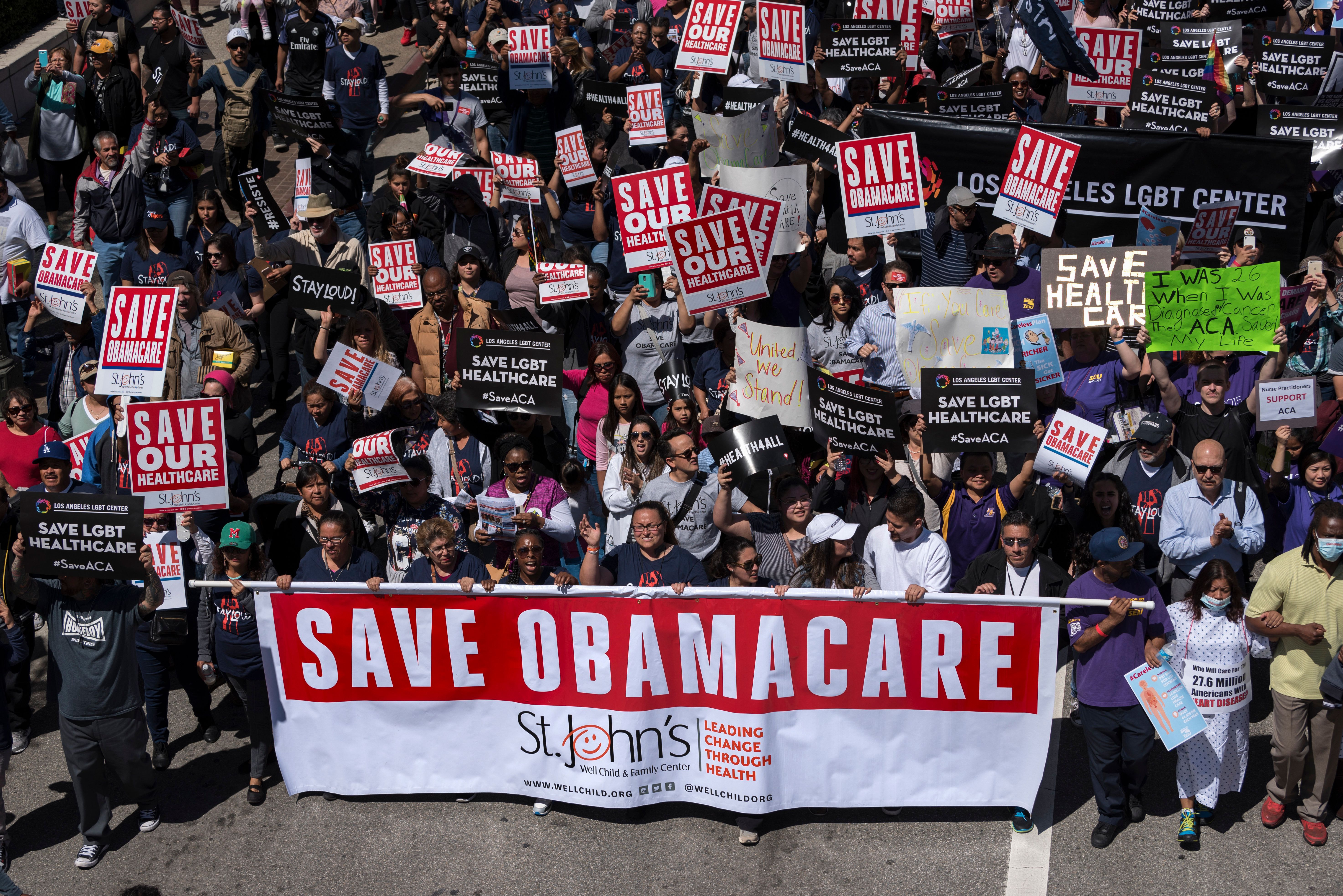 "Supporters of the Affordable Care Act participate in a ""Save Obamacare"" rally in Los Angeles, California on March 23, 2017.   (Photo by Ronen Tivony/NurPhoto via Getty Images)"
