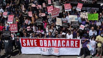 """Supporters of the Affordable Care Act participate in a """"Save Obamacare"""" rally in Los Angeles, California on March 23, 2017.   (Photo by Ronen Tivony/NurPhoto via Getty Images)"""