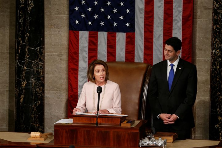 House Speaker Paul Ryan (R-Wis.) listens to House Democratic Leader Nancy Pelosi (D-Calif.) during the opening session of the