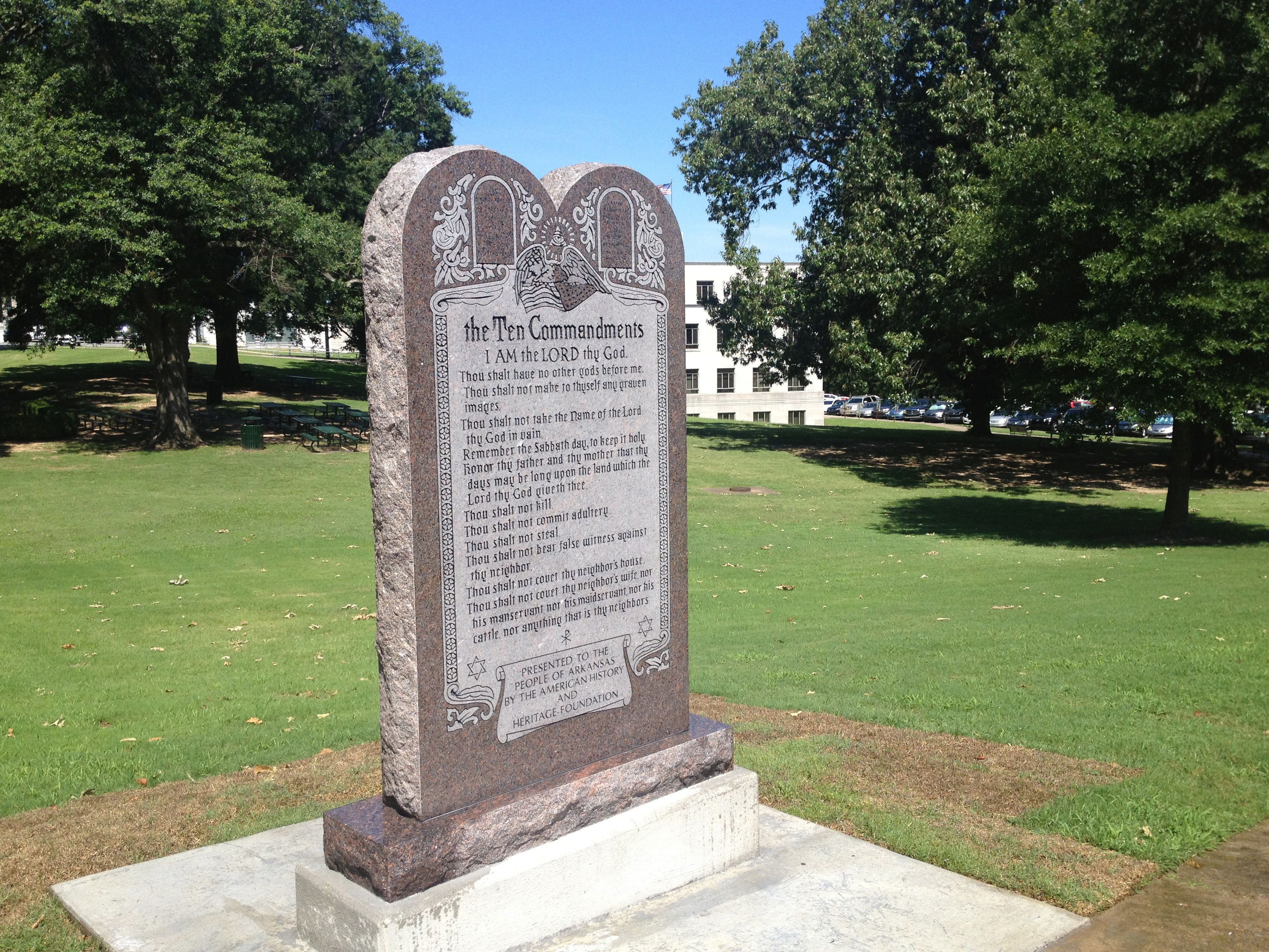 A monument of the Ten Commandments on the grounds of the state Capitol in Little Rock, Arkansas, was destroyed Wednesday less