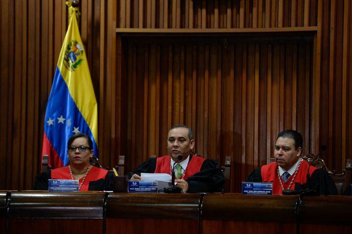 Venezuela's Supreme Court President Maikel Moreno (C) speaks during a press conference in Caracas.