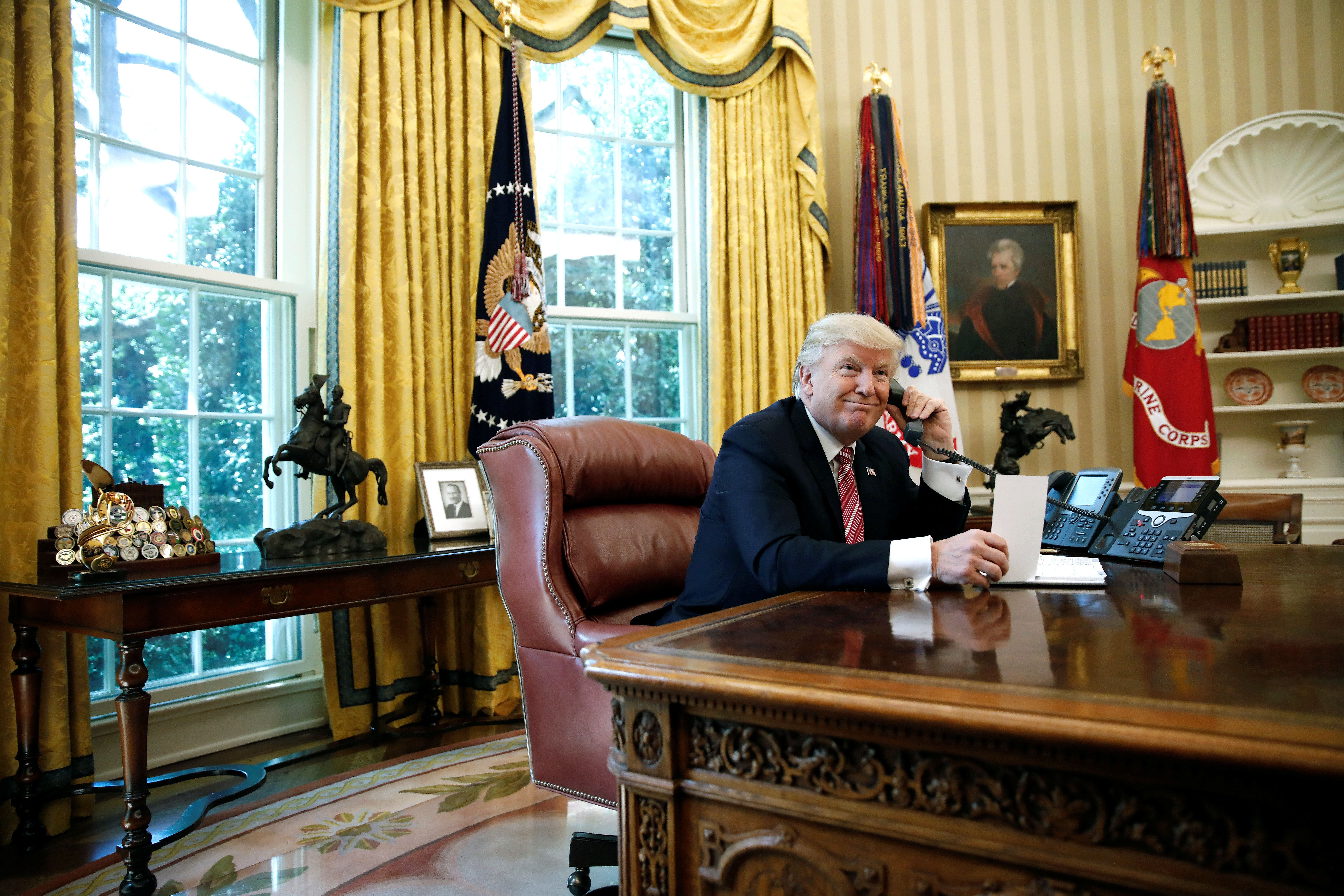 U.S. President Donald Trump waits on the line as he calls Prime Minister of Ireland Leo Varadkar to congratulate him for his victory, at the Oval Office of the White House in Washington, U.S., June 27, 2017. REUTERS/Carlos Barria