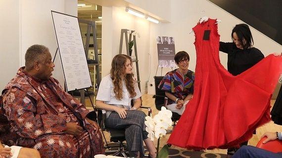 Saint Louis Fashion Incubator Designer Agnes Hamerlik showing her dress to  André Leon Talley